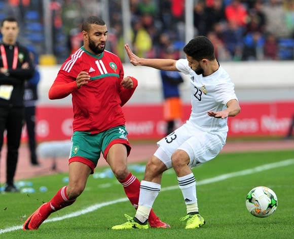 Ismail El Haddad of Morocco is fouled by Omar Aribi Hammad of Libya during the 2018 Chan semifinal game between Morocco and Libya at Stade Mohamed in Casablanca, Morocco on 31 January 2018 © Ryan Wilkisky/BackpagePix