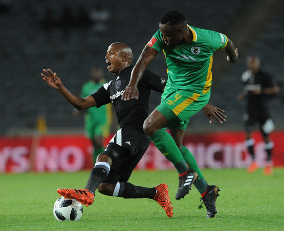 Luvuyo Memela of Orlando Pirates is tackled by Letladi Madubanya of Baroka FC during the Absa Premiership match between Orlando Pirates and Baroka FC on 06 January 2018 at Orlando Stadium Pic Sydney Mahlangu/BackpagePix