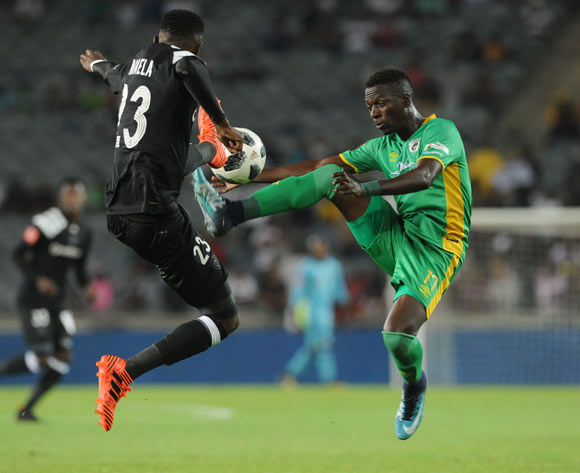 Innocent Maela of Orlando Pirates is challenged by Robin Ngalane of Baroka FC during the Absa Premiership match between Orlando Pirates and Baroka FC on 06 January 2018 at Orlando Stadium Pic Sydney Mahlangu/BackpagePix
