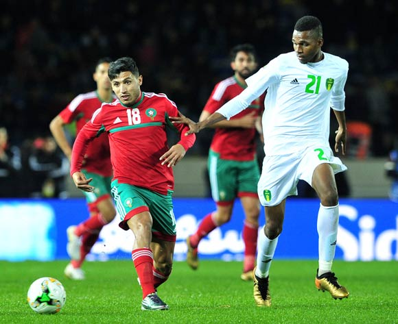 Abdelilah Hafidi of Morocco gets his pass away as he is challenged by Mbark El Id Abdou of Mauritania during the 2018 Chan game between Morocco and Mauritania at Stade Mohammed V in Casablanca, Morocco on 13 January 2018 © Ryan Wilkisky/BackpagePix