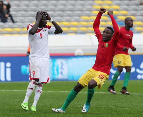 Saifeldin Malik Bakhit of Sudan reacts in disappointment after missing  penalty, Daouda Bangoura of Guinea celebrates during the 2018 Chan football game between Guinea and Sudan at Stade Mohammed V in Casablanca, Morocco on 14 January 2018 ©Gavin Barker/BackpagePix