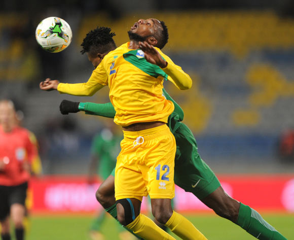 Stephen Eze of Nigeria challenges Justin Mico of Rwanda during the CHAN Group C match between Nigeria and Rwanda on 15 January 2018 at Grand Stade de Tanger, Tanger Morocco Pic Sydney Mahlangu/BackpagePix