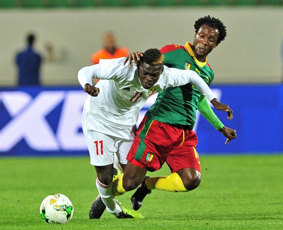 Vieljeux Prestige Mboungou of Congo is fouled by Ngoundo Kouoh Bille of Cameroon during the 2018 Chan game between Cameroon and Congo at Le Grand Stade Agadir in Agadir, Morocco on 16 January 2018 © Ryan Wilkisky/BackpagePix