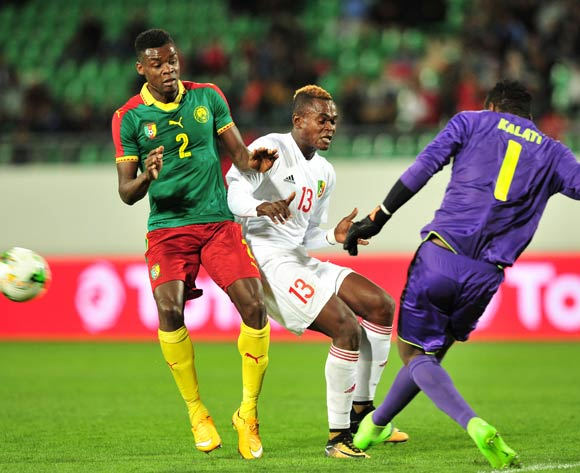 Oscar Gwot Kalati of Cameroon clears the ball ahead of Jaures Maudsly Ngombe of Congo as Bertrand Owundi of Cameroon looks on during the 2018 Chan game between Cameroon and Congo at Le Grand Stade Agadir in Agadir, Morocco on 16 January 2018 © Ryan Wilkisky/BackpagePix