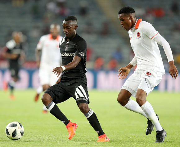 Justin Shonga of Orlando Pirates challenged by Sammy Seabi of Polokwane City during the Absa Premiership 2017/18 match between Orlando Pirates and Polokwane City at Orlando Stadium, Soweto South Africa on 20 January 2018 ©Muzi Ntombela/BackpagePix