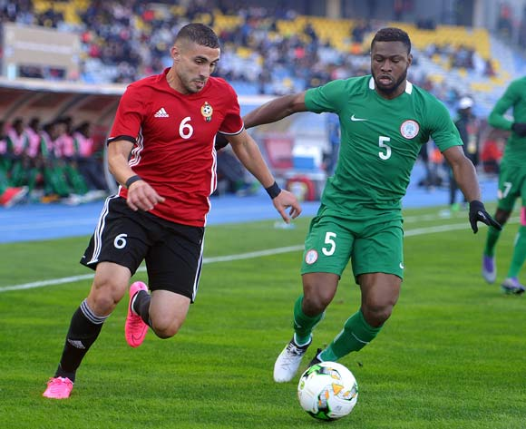 Mohamed Abrahim Aleyat of Libya is tackled by Kalu Orji Okogbue of Nigeria during the CHAN Group C match between Libya and Nigeria on 19 January 2018 at Grand Stade de Tanger, Tanger Morocco Pic Sydney Mahlangu/BackpagePix