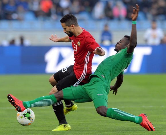 Omar Aribi Hammad of Libya  is tackled by Daniel James of Nigeria during the CHAN Group C match between Libya and Nigeria on 19 January 2018 at Grand Stade de Tanger, Tanger Morocco Pic Sydney Mahlangu/BackpagePix