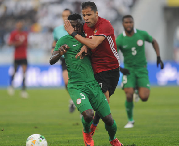 Salem Ablo of Libya  is tackled by Daniel James of Nigeria during the CHAN Group C match between Libya and Nigeria on 19 January 2018 at Grand Stade de Tanger, Tanger Morocco Pic Sydney Mahlangu/BackpagePix