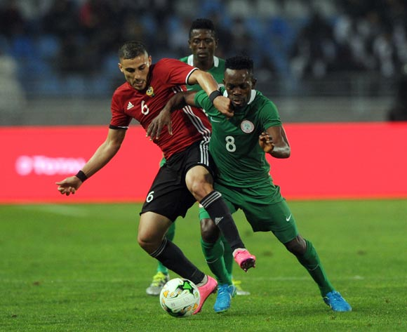 Ifeanyi Ifeanyi of Nigeria  is challenged by Mohamed Abrahim Aleyat of Libya during the CHAN Group C match between Libya and Nigeria on 19 January 2018 at Grand Stade de Tanger, Tanger Morocco Pic Sydney Mahlangu/BackpagePix