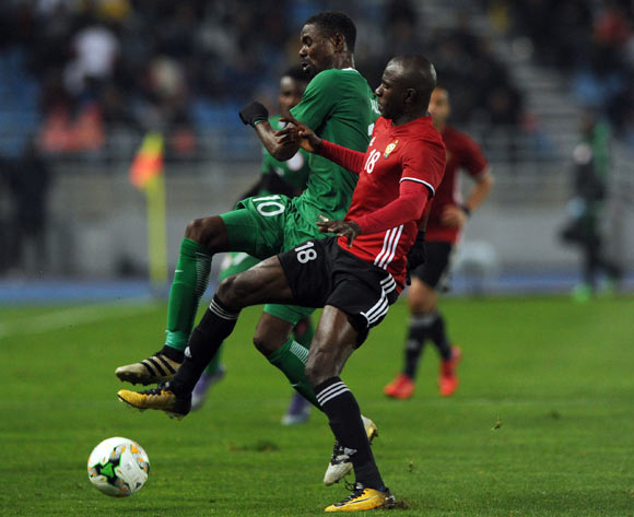 Rabiu Ali of Nigeria challenges Ahmed Bader Hasan of Libya during the CHAN Group C match between Libya and Nigeria on 19 January 2018 at Grand Stade de Tanger, Tanger Morocco Pic Sydney Mahlangu/BackpagePix