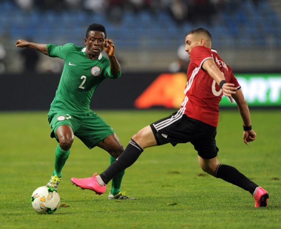 Moses Okoro Osas of Nigeria is challenged by Mohamed Abrahim Aleyat of Libya during the CHAN Group C match between Libya and Nigeria on 19 January 2018 at Grand Stade de Tanger, Tanger Morocco Pic Sydney Mahlangu/BackpagePix