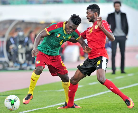 Thomas Bawak Etta of Cameroon is tackled by Herenilson Do Carmo of Angola during the 2018 Chan game between Angola and Cameroon at Le Grand Stade Agadir in Agadir, Morocco on 20 January 2018 © Ryan Wilkisky/BackpagePix