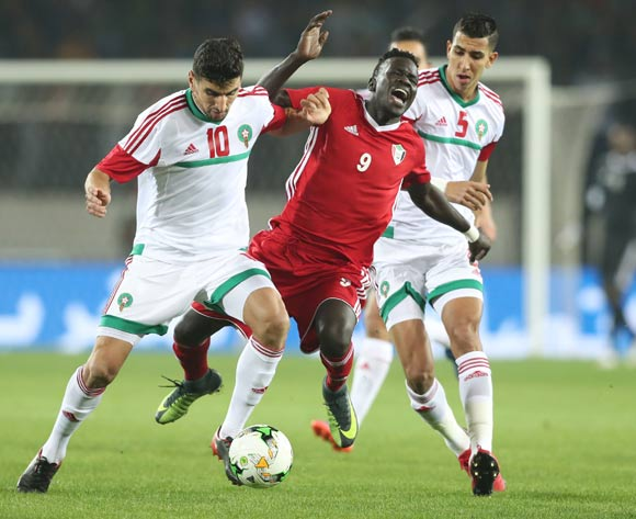 Saifeldin Malik Bakhit of Sudan challenged by Walid El Karti (l) and Jawad El Yamiq of Morocco (r) and during the 2018 Chan football game between Sudan and Morocco at Stade Mohammed V in Casablanca, Morocco on 21 January 2018 ©Gavin Barker/BackpagePix