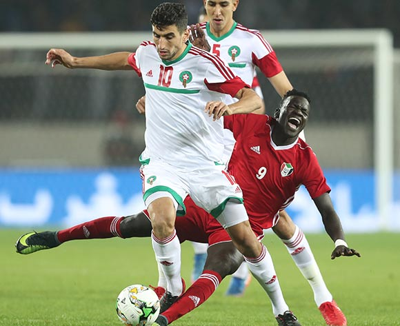 Saifeldin Malik Bakhit of Sudan (c) challenged by Walid El Karti (l) and Jawad El Yamiq of Morocco (r) during the 2018 Chan football game between Sudan and Morocco at Stade Mohammed V in Casablanca, Morocco on 21 January 2018 ©Gavin Barker/BackpagePix