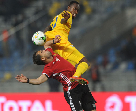 Thierry Manzi of Rwanda challenges Abdelsalam Faraj Alaqoub of Libya during the CHAN Group C match between Rwanda and Libya on 23 January 2018 at Grand Stade de Tanger, Tanger Morocco Pic Sydney Mahlangu/BackpagePix
