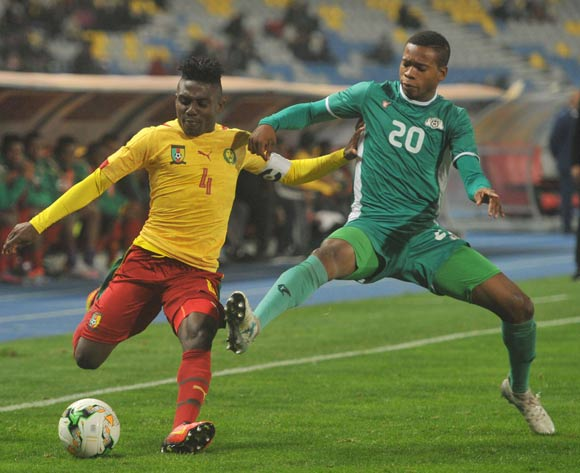 Thomas Bawak Etta of Cameroon is challenged by Nathanio Kompaore of Burkina Faso during the CHAN Group D match between Burkina Faso and Cameroon on 24 January 2018 at Grand Stade de Tanger, Tanger Morocco Pic Sydney Mahlangu/BackpagePix