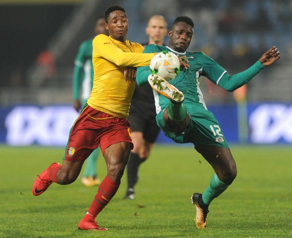 Raphael Eric Messi Bouli of Cameroon is challenged by Abdoul Abass Guiro of Burkina Faso during the CHAN Group D match between Burkina Faso and Cameroon on 24 January 2018 at Grand Stade de Tanger, Tanger Morocco Pic Sydney Mahlangu/BackpagePix