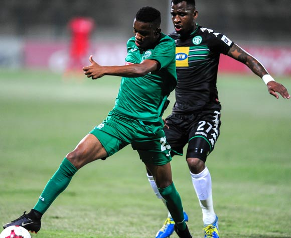 Ovidy Karuru of AmaZulu FC stretches to get to the ball before Alfred Ndengane of Bloemfontein Celtic during the Absa Premiership 2017/18 match between AmaZulu FC and Bloemfontein Celtic at King Zwelithini Stadium, Kwazulu Natal South Africa on 24 January 2018 ©Gerhard Duraan/BackpagePix