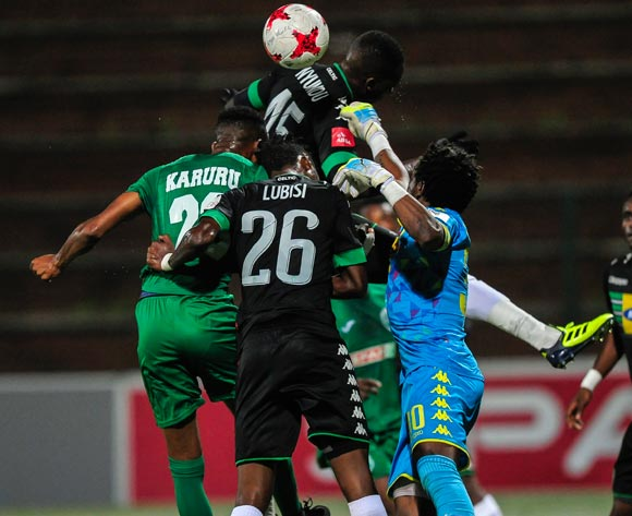 Ovidy Karuru of AmaZulu FC is in them to get the ball midair to score. Preventing him is Aphiwe Lubisi and Roggert Nyundu of Bloemfontein Celtic and the goalkeeper Patrick Tignyemb of Bloemfontein Celtic during the Absa Premiership 2017/18 match between AmaZulu FC and Bloemfontein Celtic at King Zwelithini Stadium, Kwazulu Natal South Africa on 24 January 2018 ©Gerhard Duraan/BackpagePix