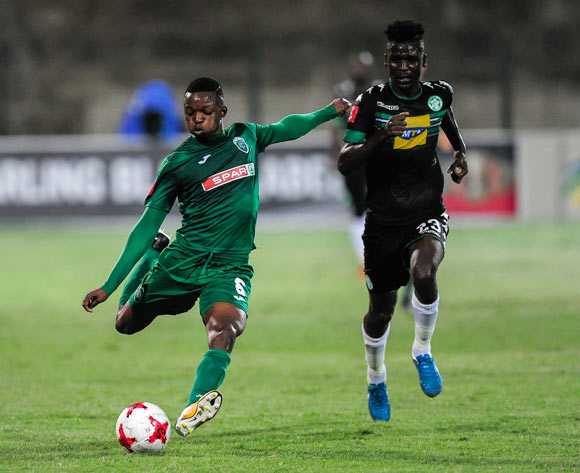 Butholezwe Ncube of AmaZulu FC boots the ball as Vusi Shikweni of Bloemfontein Celtic gives up the chase during the Absa Premiership 2017/18 match between AmaZulu FC and SuperSport United at King Zwelithini Stadium, Kwazulu Natal South Africa on 20 January 2018 ©Gerhard Duraan/BackpagePix
