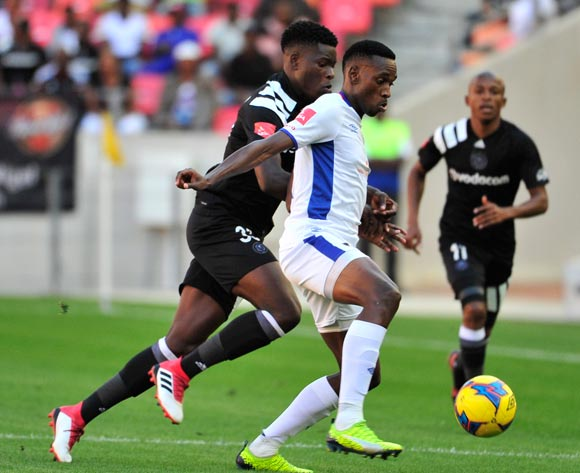 Mxolisi Macuphu of Chippa United and Marshall Munetsi of Pirates during the Absa Premiership 2017/18 match between Chippa United and Orlando Pirates at Nelson Mandela Bay Stadium, Port Elizabeth South Africa on 25 February 2018 ©/BackpagePix