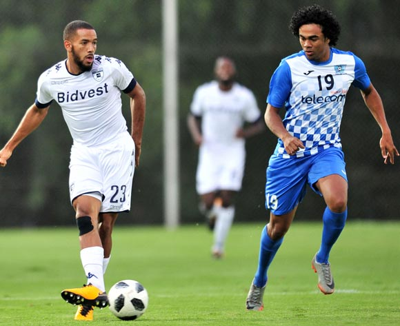 Reeve Frosler of Bidvest Wits challenged by Joseph Stephan Kevin Perticots of Pamplemousses during the 2018 CAF Champions League football match between Bidvest Wits and Pamplemousses at Bidvest Stadium, Johannesburg on 10 February 2018 ©Samuel Shivambu/BackpagePix