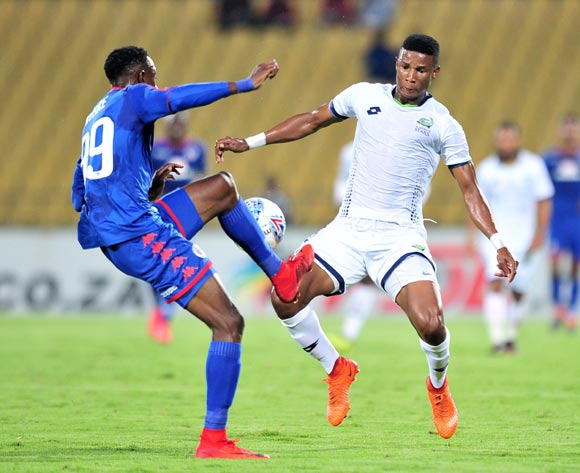 Evans Rusike of Supersport United challenged by Sibusiso Mthethwa of Platinum Stars during the Absa Premiership 2017/18 match between Platinum Stars and Supersport United at Royal Bafokeng Stadium, Rustenburg on 20 February 2018 ©Samuel Shivambu/BackpagePix