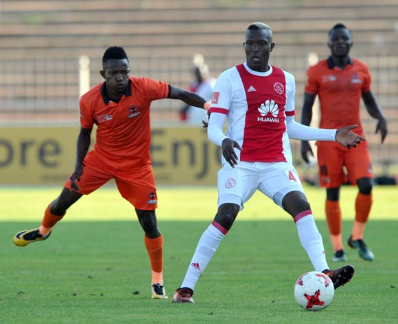 Tendai Ndoro of Ajax Cape Town is challenged by Mondli Miya of Polokwane City during the Absa Premiership match between Polokwane City and Ajax Cape Town on 04 February 2018 at  Old Peter Mokaba Stadium Pic Sydney Mahlangu/BackpagePix