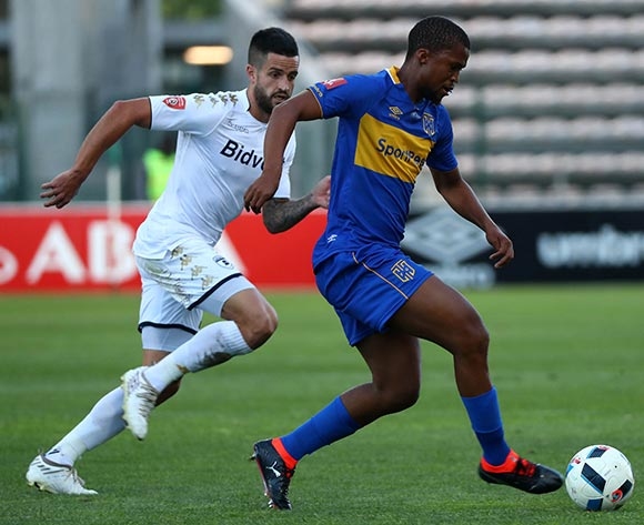 Tshepo Gumede of Cape Town City evades challenge from Keegan Ritchie of Bidvest Wits during the Absa Premiership 2017/18 football match between Cape Town City FC and Bidvest Wits at Athlone Stadium, Cape Town on 24 February 2018 ©Chris Ricco/BackpagePix