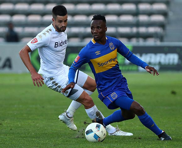 Teko Modise of Cape Town City evades challenge from Keegan Ritchie of Bidvest Wits during the Absa Premiership 2017/18 football match between Cape Town City FC and Bidvest Wits at Athlone Stadium, Cape Town on 24 February 2018 ©Chris Ricco/BackpagePix
