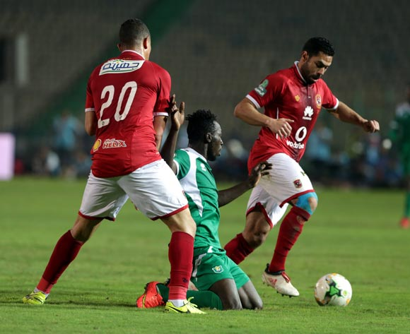 Al Ahly player Ahmed Fathy (R) and Saad Samir (L) in action against CF Mounana  player Omar Kabore (C) during the African Champions League (CAF) Round of 32 match between Al Ahlyvs CF Mounana  at international cairo Stadium in Cairo, Egypt, 06 March 2018.  EPA/KHALED ELFIQI