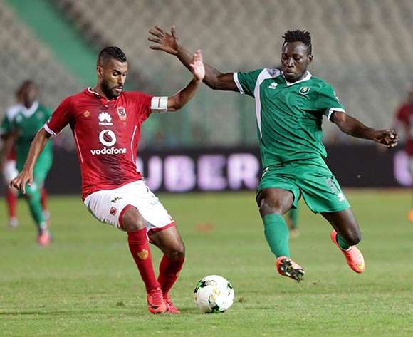 Al Ahly player Hossam Ashour (L) in action against CF Mounana  player Omar Kabore (R)during the African Champions League (CAF) Round of 32 match between Al Ahlyvs CF Mounana  at international cairo Stadium in Cairo, Egypt, 06 March 2018.  EPA/KHALED ELFIQI