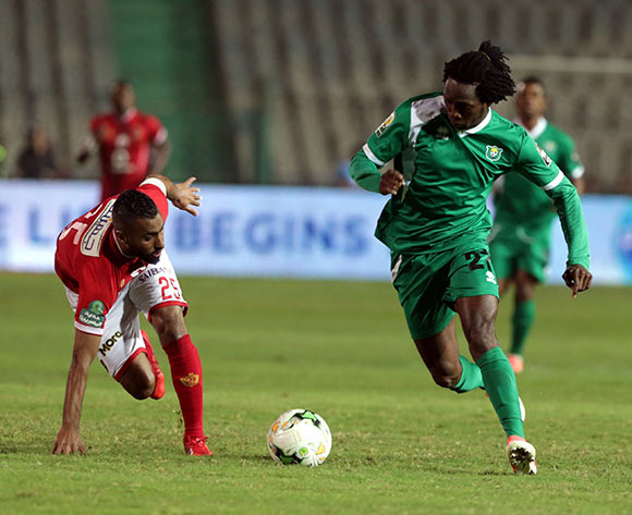 epa06585612 Al Ahly player Hossam Ashour (L) in action against CF Mounana  player CLouis Ameka Autchanga (R) during the African Champions League (CAF) Round of 32 match between Al Ahlyvs CF Mounana  at international cairo Stadium in Cairo, Egypt, 06 March 2018.  EPA/KHALED ELFIQI