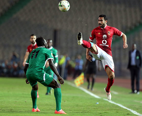 epa06585614  Al Ahly player Ahmed Fathy (R) in action against CF Mounana player Omar Kabore (L) during the African Champions League (CAF) Round of 32 match between Al Ahlyvs CF Mounana  at international cairo Stadium in Cairo, Egypt, 06 March 2018.  EPA/KHALED ELFIQI