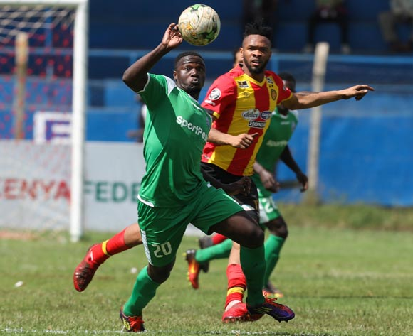 epa06587188 Ernest Wendo of Kenyan club Gor Mahia (L) vies for the ball with Fosseny Colibaly (C) of Tunisian club Esperance during the CAF Champions League first round match between Gor Mahia and Esperance Tunis in Machakos, Kenya, 07 March 2018.  EPA/DANIEL IRUNGU