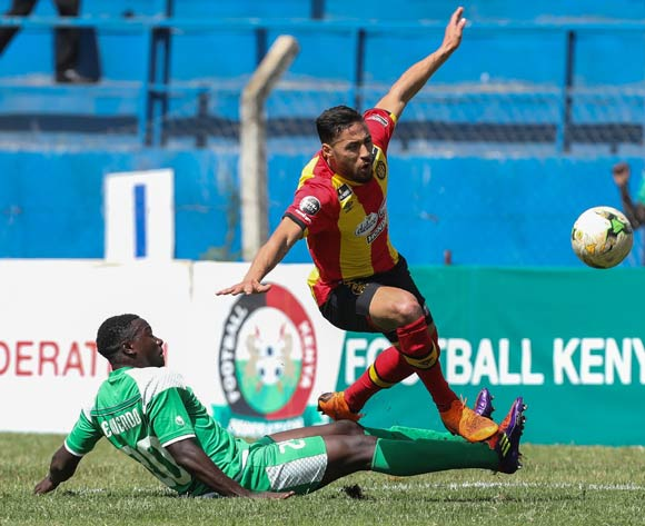 epa06587205 Ernest Wendo of Kenyan club Gor Mahia (L) vies for the ball with Bilel Nejri (R) of Tunisian club Esperance during the CAF Champions League first round match between Gor Mahia and Esperance Tunis in Machakos, Kenya, 07 March 2018.  EPA/DANIEL IRUNGU