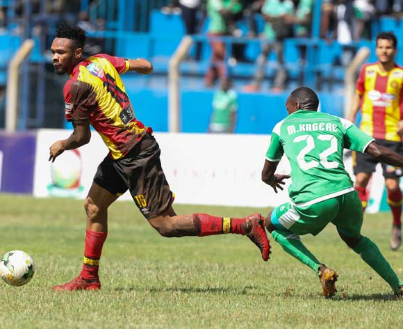 epa06587206 Medi Kagere of Kenyan club Gor Mahia (R) vies for the ball with Fosseny Colibaly (L) of Tunisian club Esperance during the CAF Champions League first round match between Gor Mahia and Esperance Tunis in Machakos, Kenya, 07 March 2018.  EPA/DANIEL IRUNGU