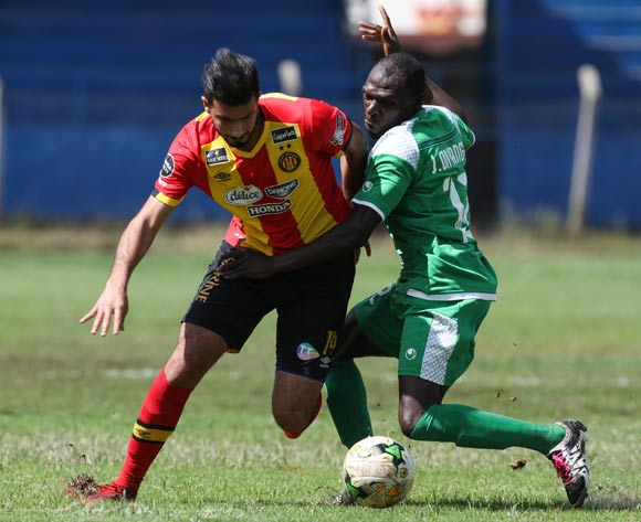 epa06587207 Joash Onyango of Kenyan club Gor Mahia (R) vies for the ball with Haythen Jovini (L) of Tunisian club Esperance during the CAF Champions League first round match between Gor Mahia and Esperance Tunis in Machakos, Kenya, 07 March 2018.  EPA/DANIEL IRUNGU