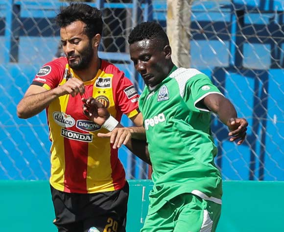epa06587280 Joachim Ochieng of Kenyan club Gor Mahia (R) vies for the ball with Yassine Khenissi (L) of Tunisian club Esperance during the CAF Champions League first round match between Gor Mahia and Esperance Tunis, in Machakos, Kenya, 07 March 2018.  EPA/DANIEL IRUNGU