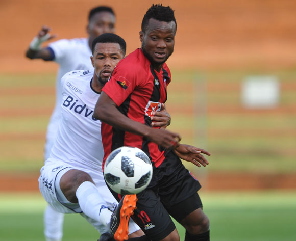 Granwald Scott of Bidvest Wits challenges Akinfenwa Ibukun of Club Desportivo de Agosto  during the CAF Champions League match Bidvest Wits and Club Desportivo de Agosto on 17 March 2018 at Bidvest Stadium  Pic Sydney Mahlangu/BackpagePix