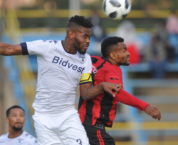 Thulani Hlatshwayo of Bidvest Wits challenges Jacques Bitumba Bakulu of Club Desportivo de Agosto during the CAF Champions League match Bidvest Wits and Club Desportivo de Agosto on 17 March 2018 at Bidvest Stadium  Pic Sydney Mahlangu/BackpagePix