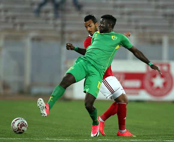 Etoile Sportive du Sahel player  Hamza Lahmar and Plateau United Football Club  player  Raphael Ayagwa  (front) fight for the ball during the CAF Champions League soccer match between Etoile Sportive du Sahel of Tunisia and Plateau United Football Club  of Nigeria at the Olympique Stadium in Sousse, Tunisia, 06 February 2018. MOHAMED MESSARA © BackpagePix