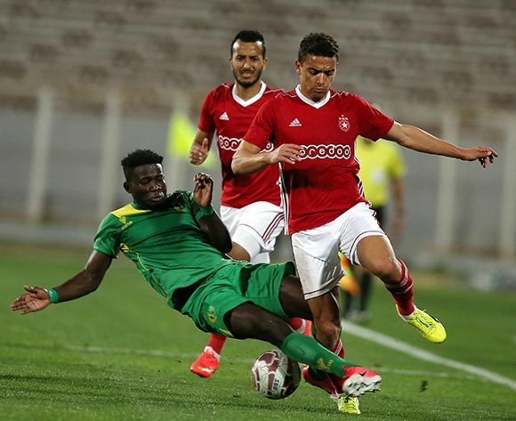 Etoile Sportive du Sahel player  Ghazi Abdelrazzek (R) and Plateau United Football Club  player  Suswam Terna (L) fight for the ball during the CAF Champions League soccer match between Etoile Sportive du Sahel of Tunisia and Plateau United Football Club  of Nigeria at the Olympique Stadium in Sousse, Tunisia, 06 February 2018. MOHAMED MESSARA © BackpagePix