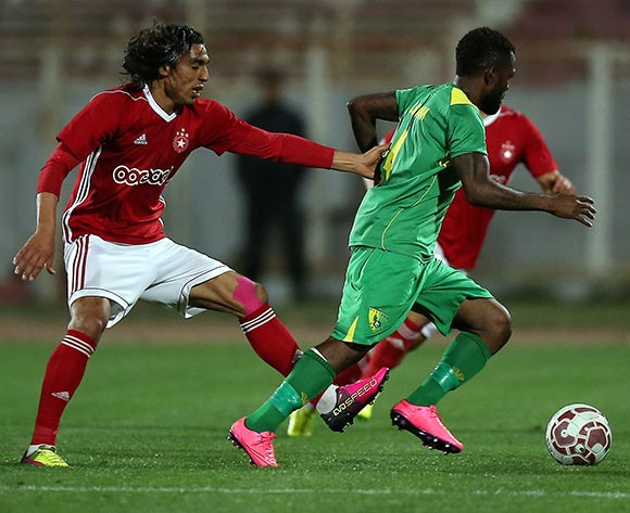 Etoile Sportive du Sahel player Amro Marei Wahba Gad  (L) and Plateau United Football Club  player   Suswam Terna (R) fight for the ball during the CAF Champions League soccer match between Etoile Sportive du Sahel of Tunisia and Plateau United Football Club  of Nigeria at the Olympique Stadium in Sousse, Tunisia, 06 February 2018. MOHAMED MESSARA © BackpagePix