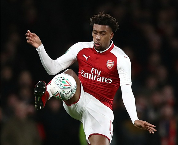 Ex-Cameroon and Arsenal player Lauren Etame Meyer offers advice with Nigerian Alex Iwobi