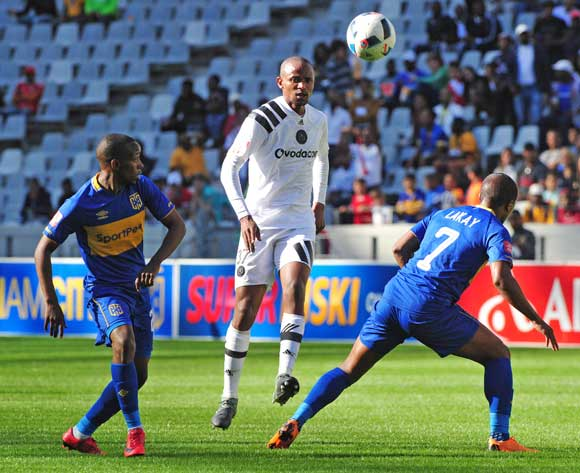 Xola Mlambo of Orlando Pirates plays a through ball as he is challenged by Thabo Nodada and Lyle Lakay of Cape Town City during the Absa Premiership 2017/18 game between Cape Town City and Orlando Pirates at Cape Town Stadium on 28 April 2018 © Ryan Wilkisky/BackpagePix
