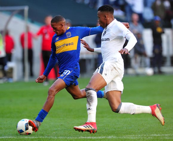 Craig Martin of Cape Town City lines up a shot at goal as Happy Jele of Orlando Pirates closes him down during the Absa Premiership 2017/18 game between Cape Town City and Orlando Pirates at Cape Town Stadium on 28 April 2018 © Ryan Wilkisky/BackpagePix