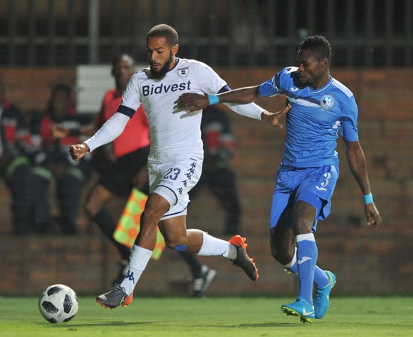 Reeve Frosler of Bidvest Wits is challenged by Francis Benjamin of Enyimba during the CAF Confederation Cup match between Bidvest Wits and Enyimba FC on 06 April  2018 at Bidvest  Stadium Pic Sydney Mahlangu/BackpagePix