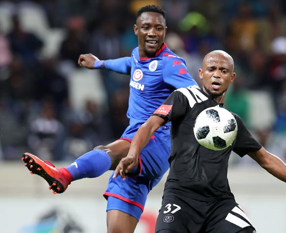 Xolani Mlambo of Orlando Pirates clears ball from Evans Rusike of Supersport United during the Absa Premiership 2017/18 match between Supersport United and Orlando Pirates at Mbombela Stadium, Johannesburg on 11 April 2018 ©Muzi Ntombela/BackpagePix