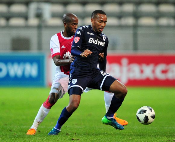 Lehlonolo Majoro of Bidvest Wits is challenged by Mosa Lebusa of Ajax Cape Town during the Absa Premiership 2017/18 game between Ajax Cape Town and Bidvest Wits at Athlone Stadium, Cape Town on 11 April 2018 © Ryan Wilkisky/BackpagePix
